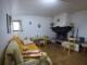 Salon / salle à manger dans l'appartement au rez-de-chaussée.