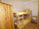 Chambre à coucher dans l'appartement du rez-de-chaussée.